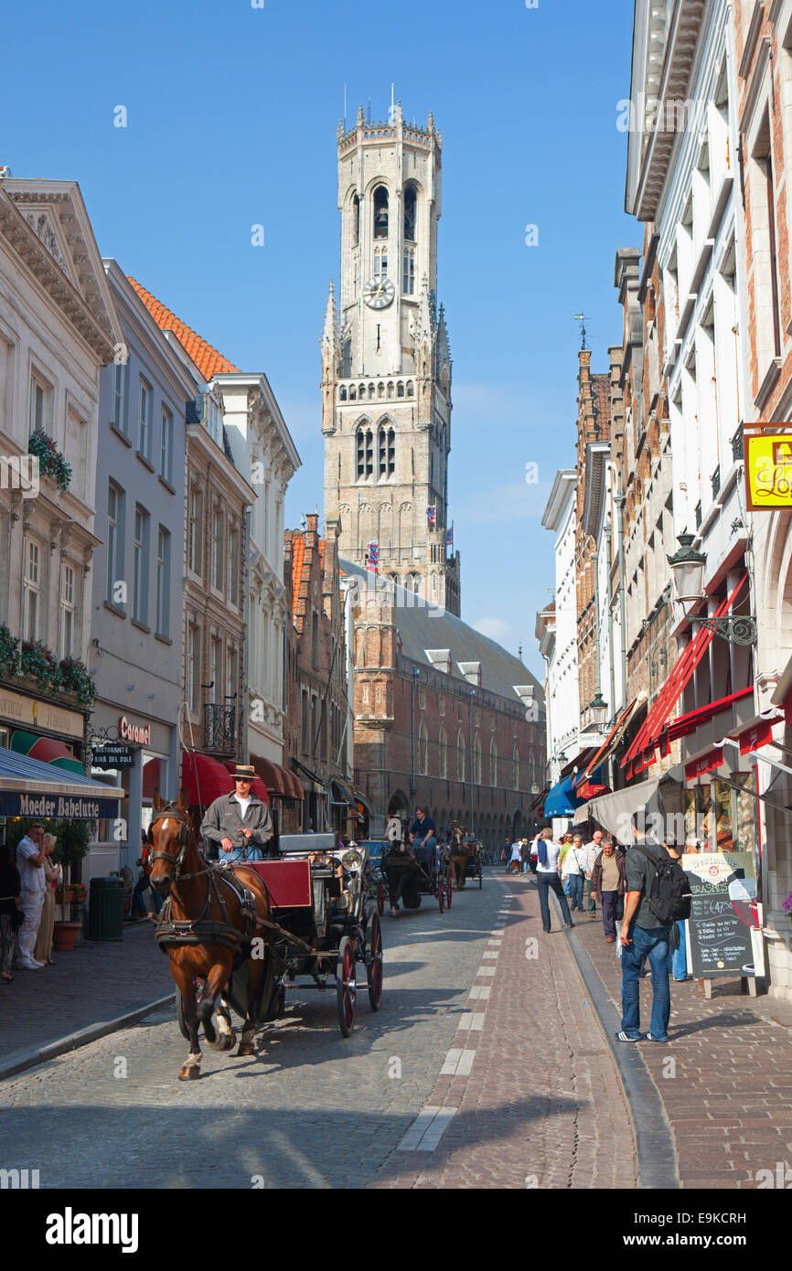 BELFRY TOWER IN BRUGES WITH HORSE AND CARRIAGE - Stock Image