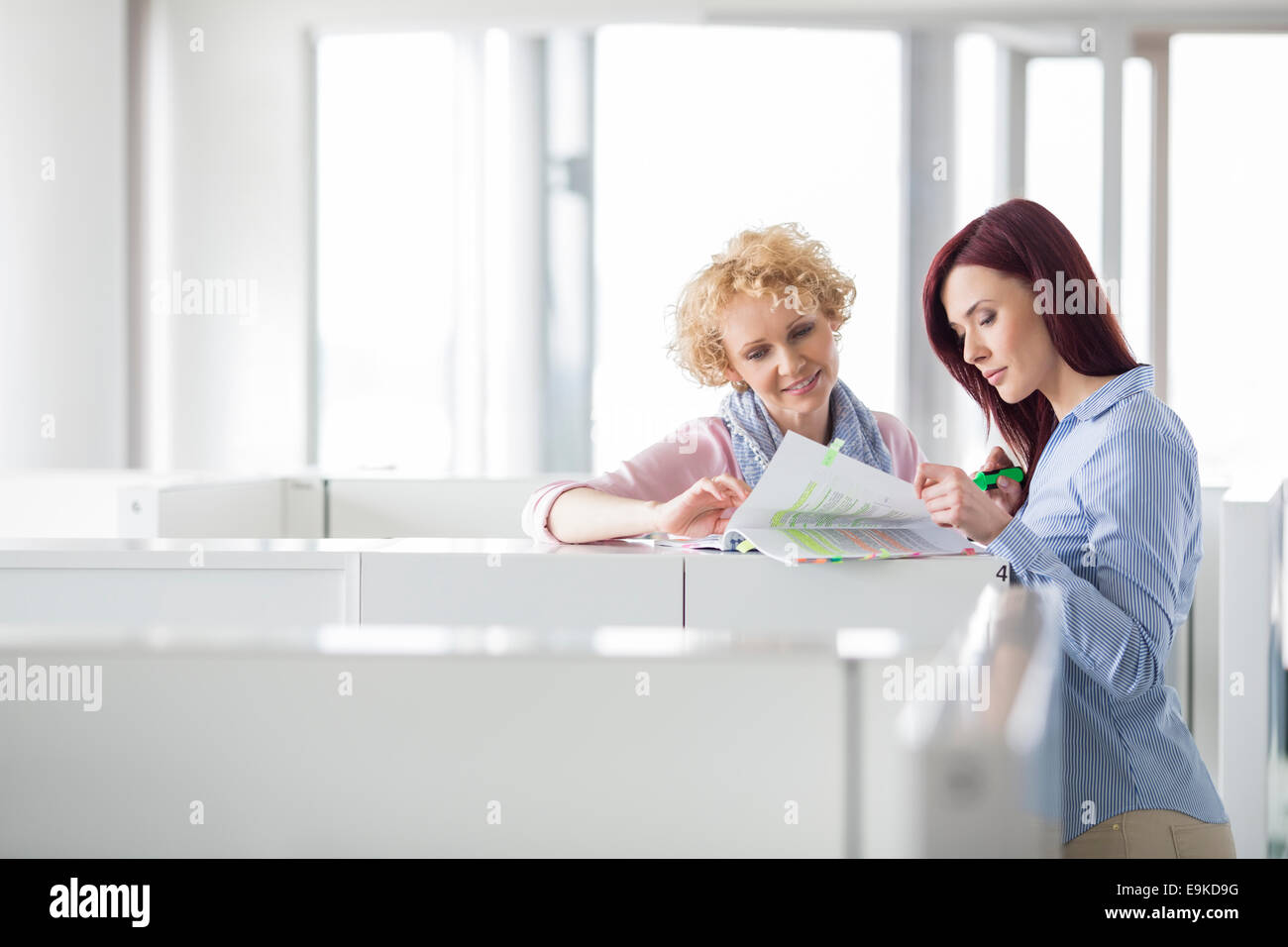 Businesswomen discussing in creative office - Stock Image