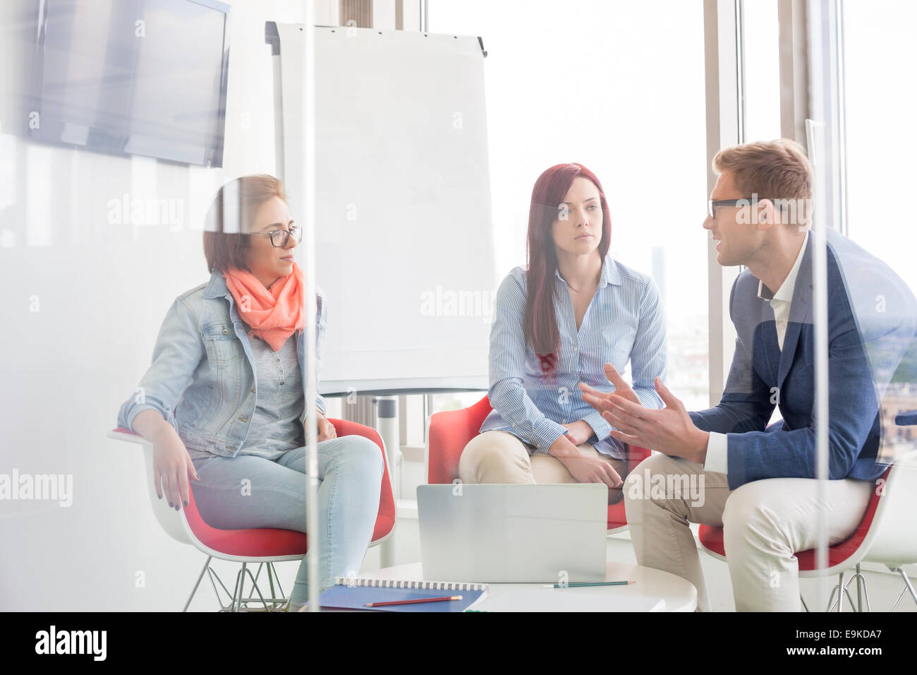 Business people discussing in meeting room Stock Photo