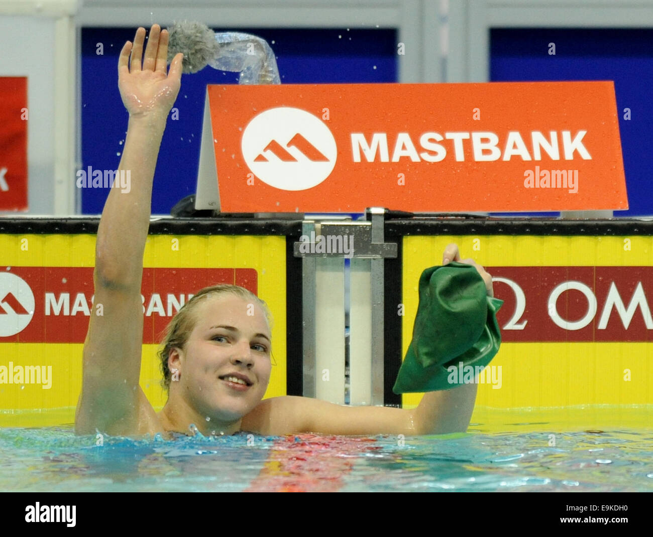 Tokyo, Japan. 29th Oct, 2014. Ruta Meilutyte of Lithuania waves after the women's 50m breaststroke final at - Stock Image