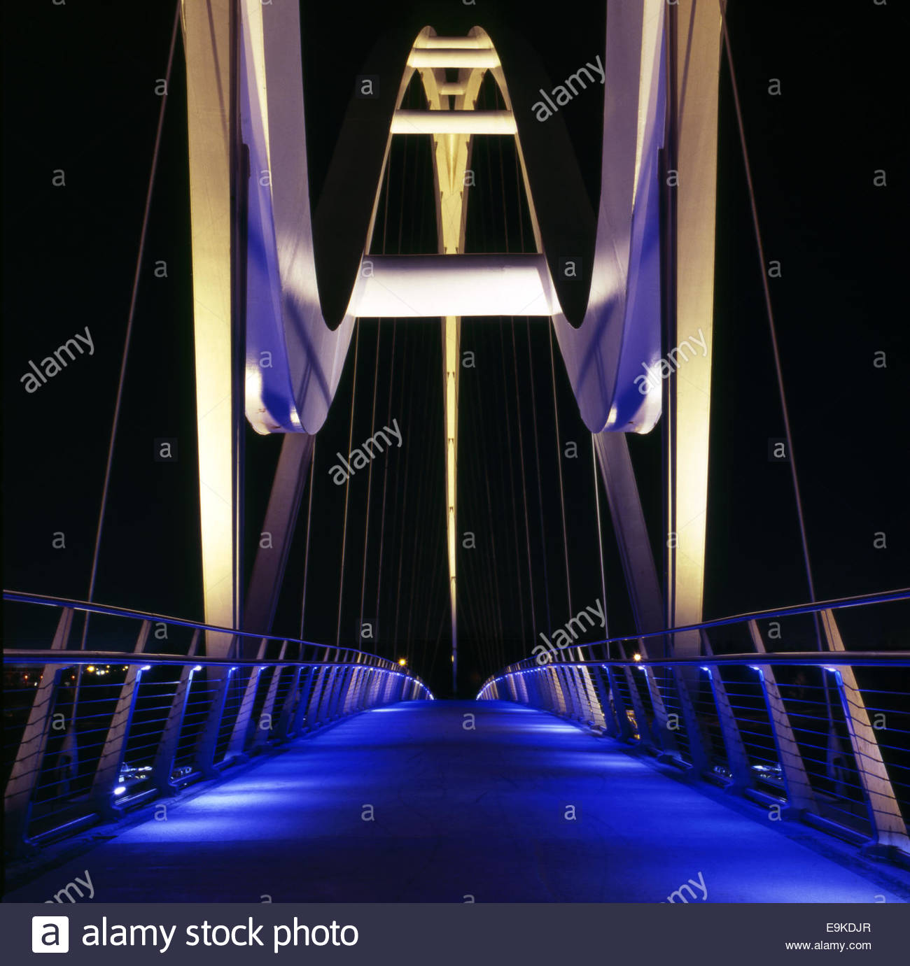 The Infinity Bridge (pedestrian & cyclist route) at night, across the River Tees, in Stockton-on-Tees, UK. Stock Photo
