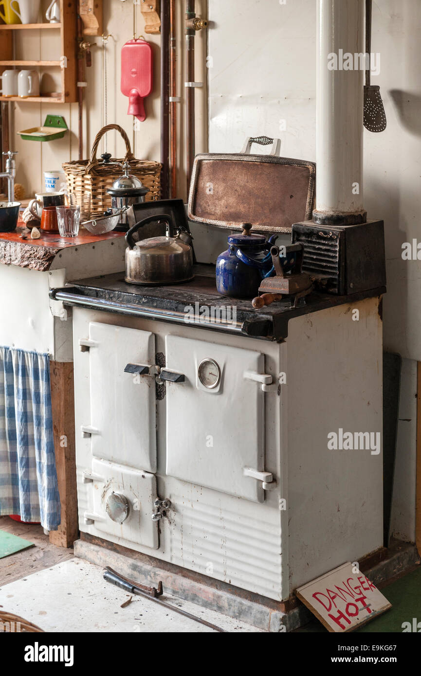 An old solid fuel Rayburn cooker in an old fashioned English farm kitchen - Stock Image