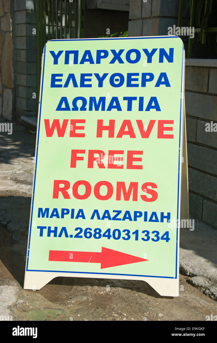 An ambiguous sign outside a Greek guest house. - Stock Image