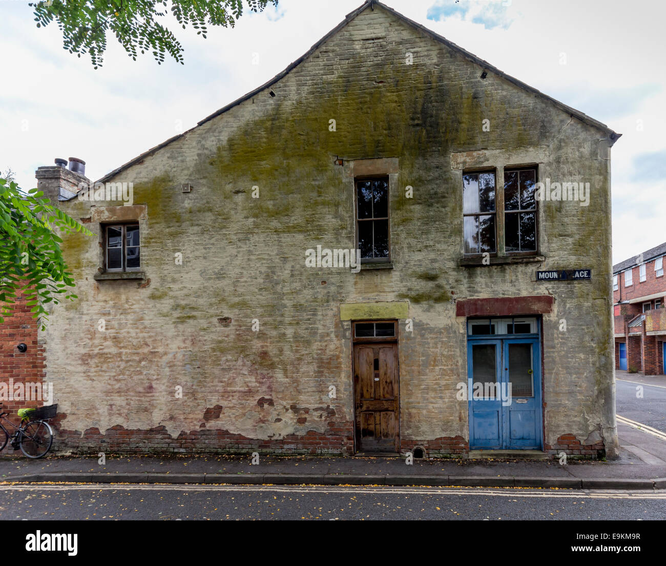 Old house in need of some TLC and refurbishment with mould growing on the walls - Stock Image