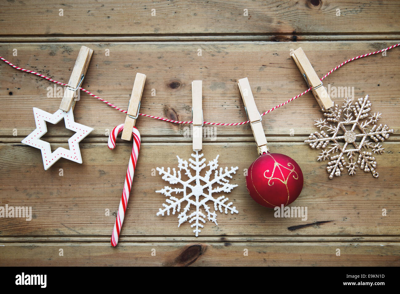 Christmas ornaments on a wooden background - Stock Image