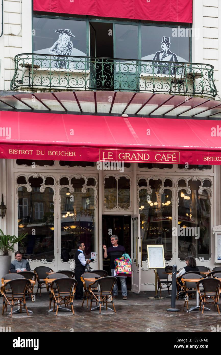 Waiter serving client at Bistro Le Grand Café at Moulins, Auvergne, Allier, France - Stock Image
