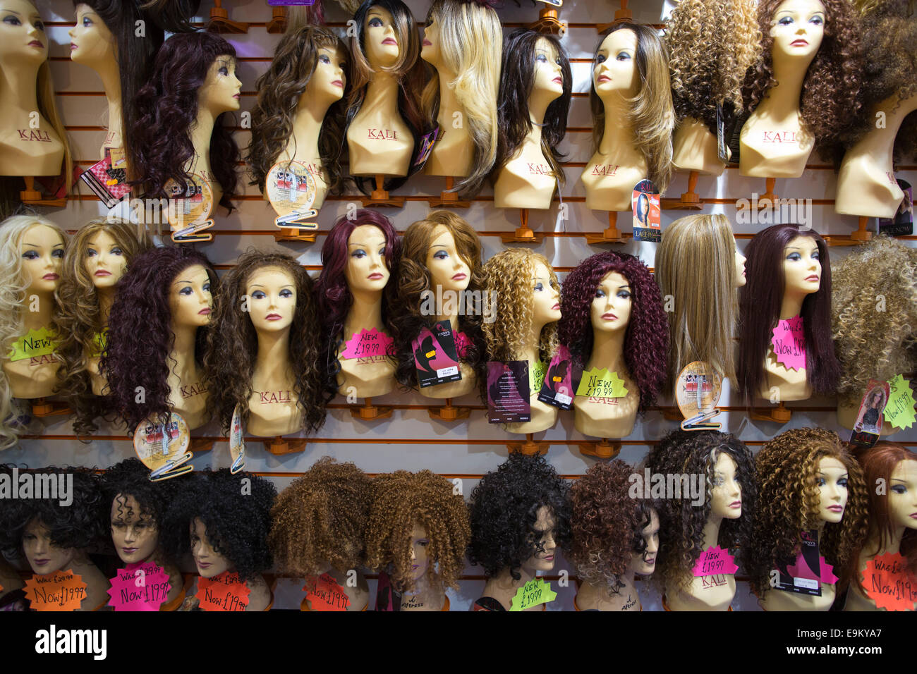 Wigs on sale in a Harlesden hair boutique, Northwest London, England, UK - Stock Image
