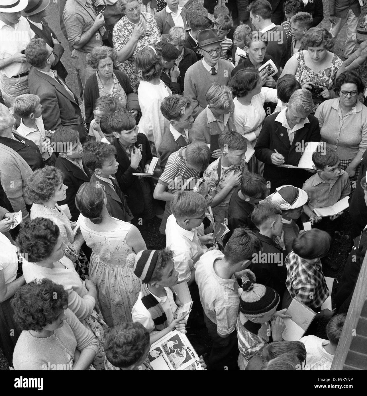 Football fans autograph hunters children crowd waiting for Billy Wright after his final match at Molineux August - Stock Image