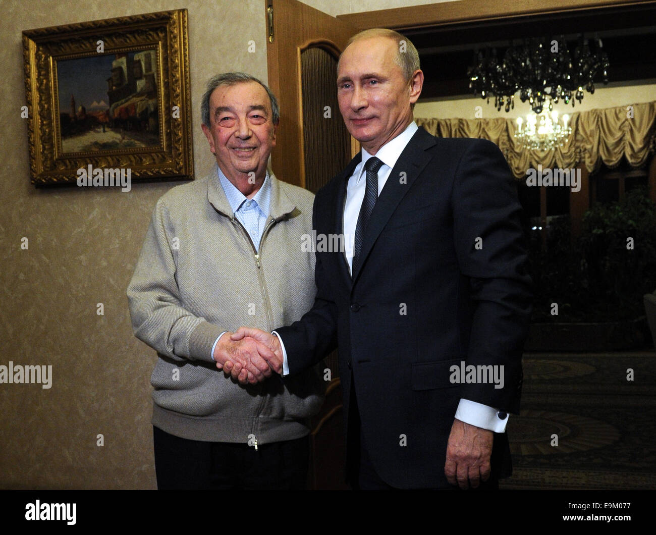 Moscow Region, Russia. 29th Oct, 2014. President of Russia Vladimir Putin (R) congratulates a respected Russian Stock Photo