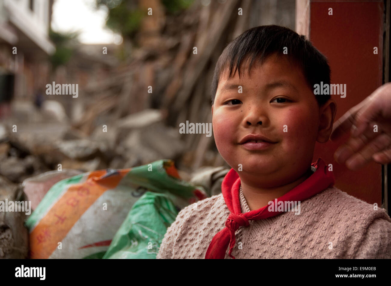 Young Chinese boy with red neckerchief, Suoga, Guizhou Province, China - Stock Image