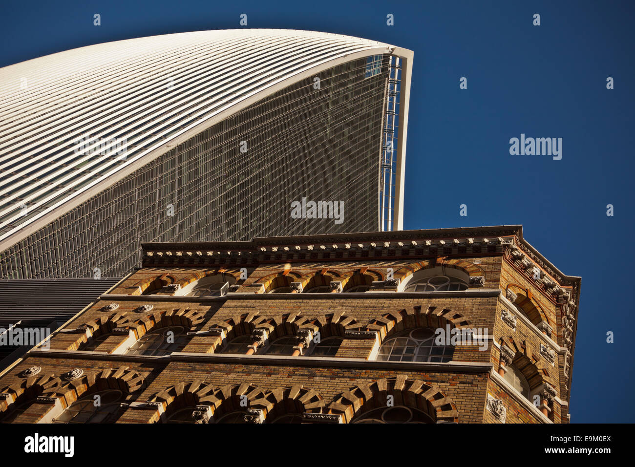 20 Fenchurch St, London, the walkie talkie buliding next to an older building - Stock Image