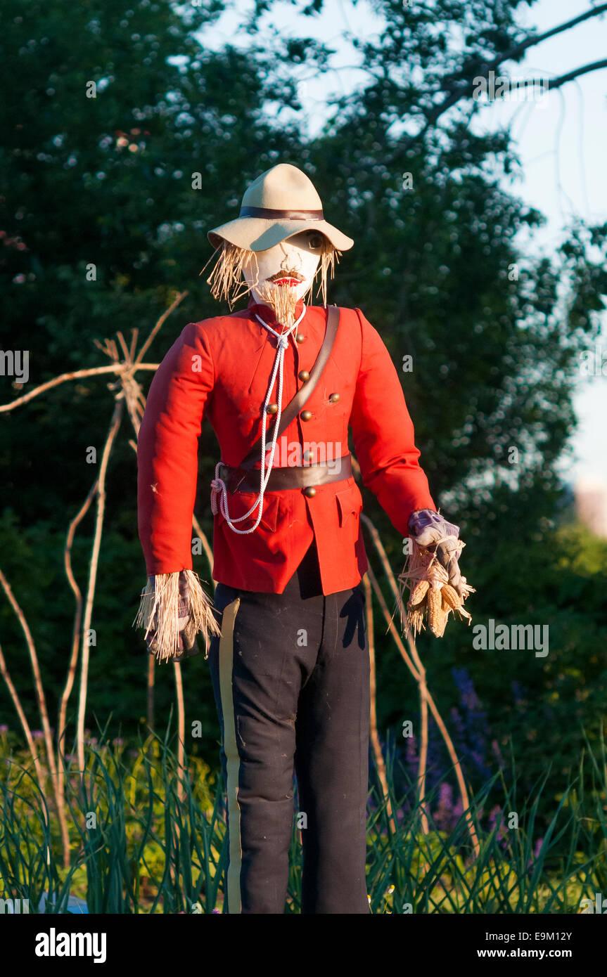 Northwest Mounted Police scarecrow, Heritage Garden, Fort Calgary, Alberta, Canada - Stock Image