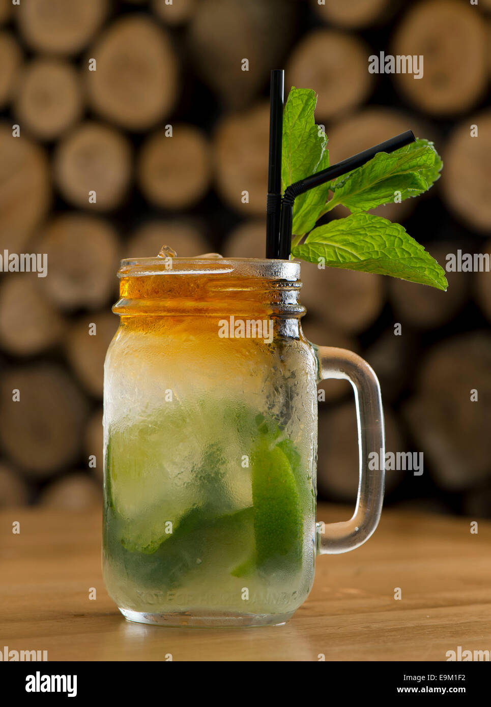 A mojito alcoholic cocktail served with mint, limes, sugar and rum in a bar. - Stock Image