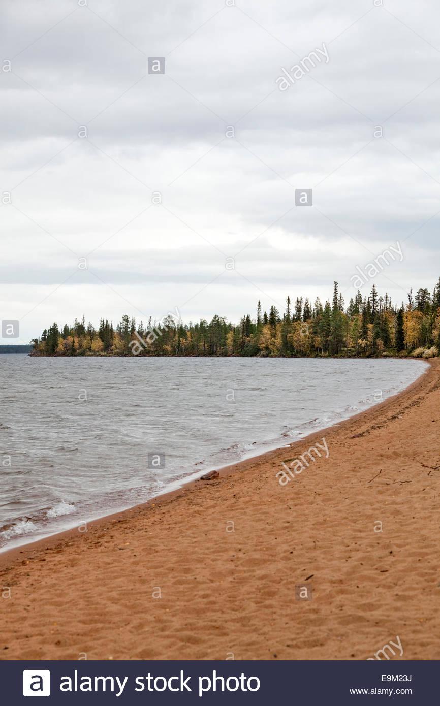 Red sand beach - Stock Image