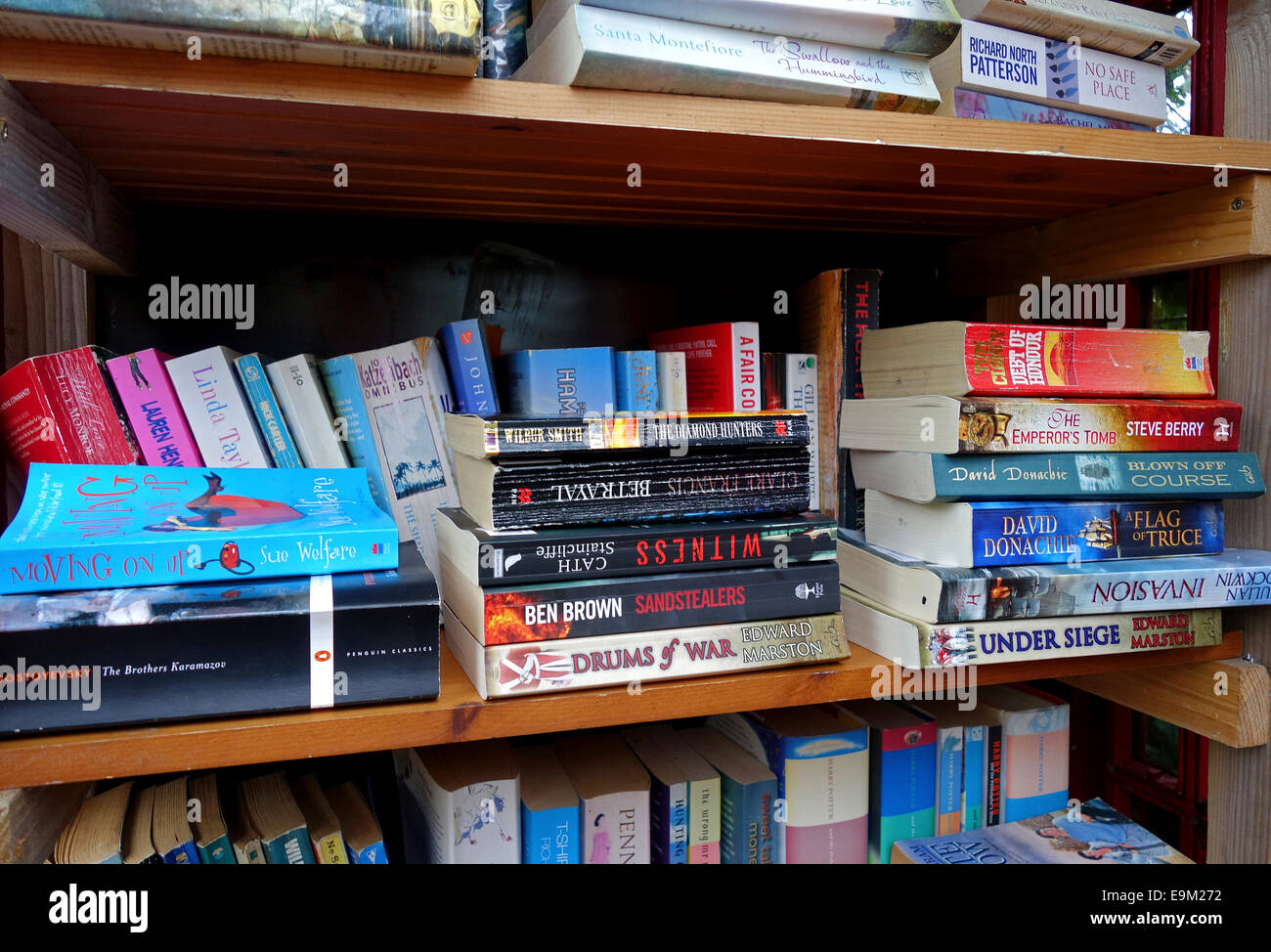 Paperback books library - Stock Image