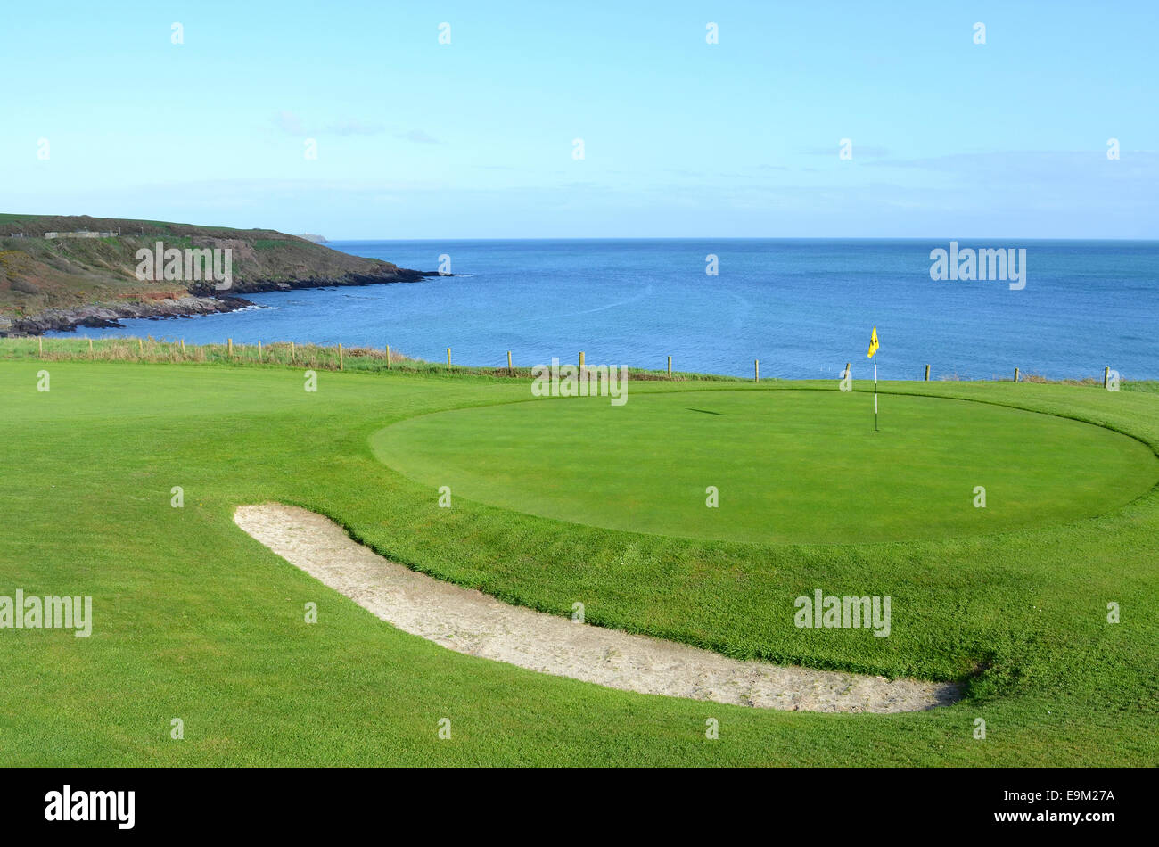 Golf course on the Irish coast near Trabolgan. - Stock Image