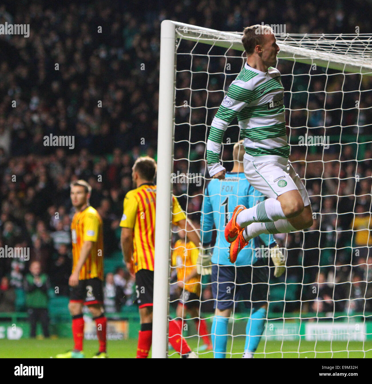 Glasgow, Scotland. 29th Oct, 2014. Scottish League Cup. Celtic versus Partick Thistle. Leigh Griffiths jumps for - Stock Image