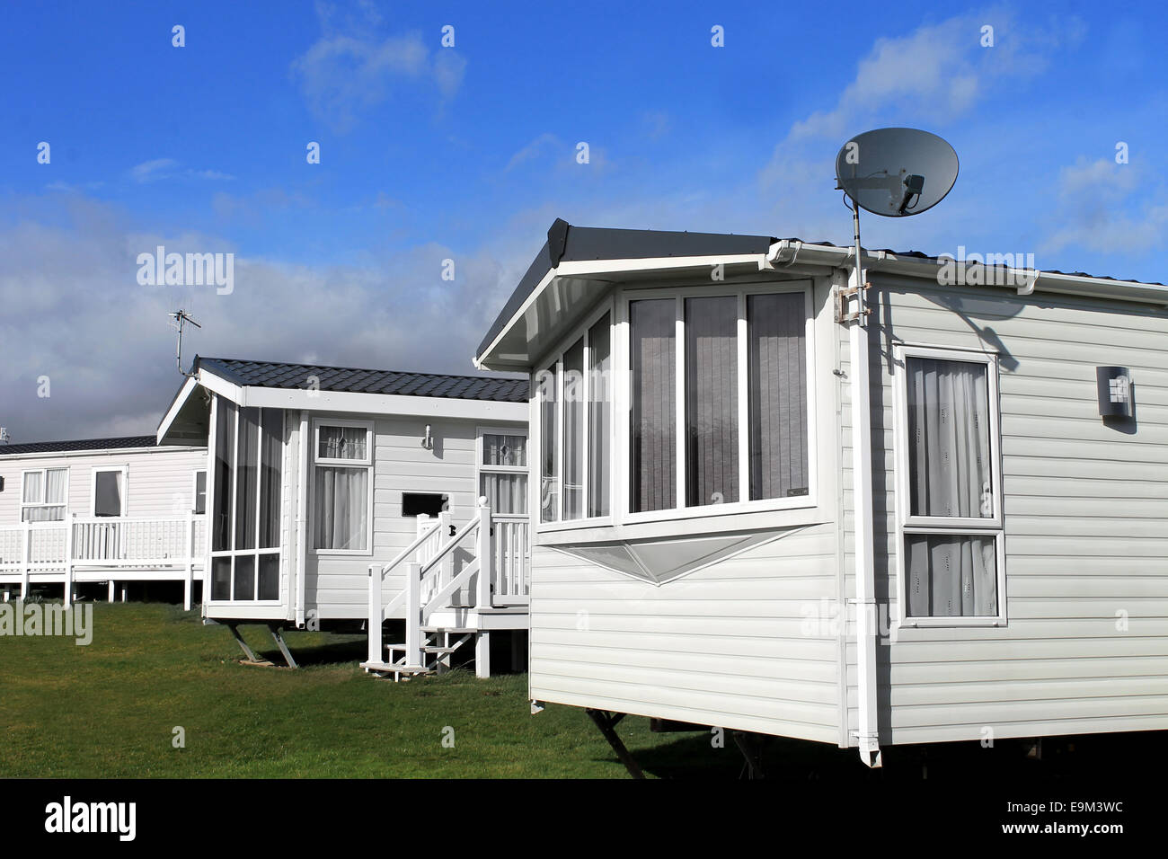 Scenic view of a caravan or trailer park in summer with blue sky and cloudscape background. Stock Photo