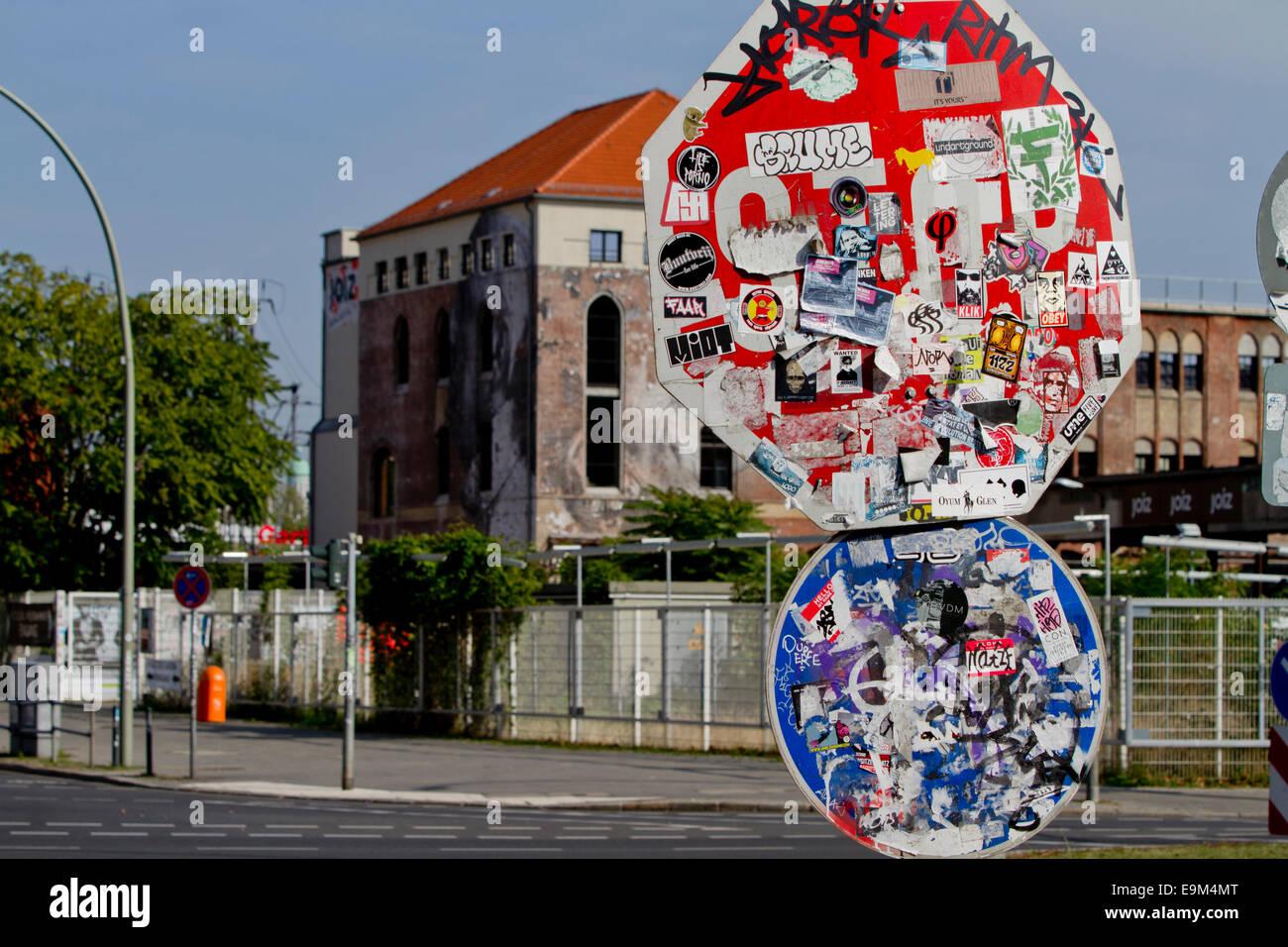 street furniture signs graffiti colourful bulbs - Stock Image
