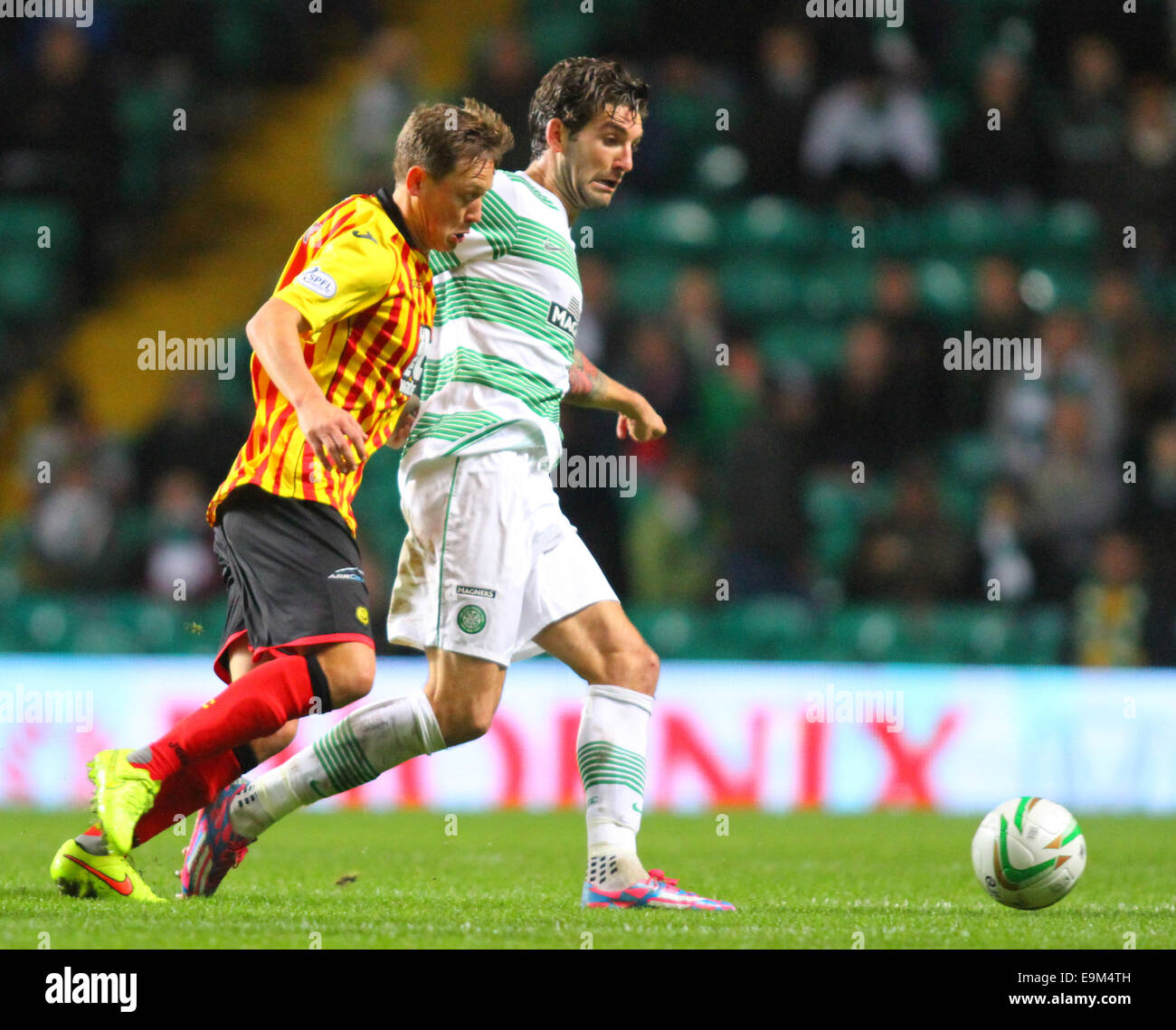 Glasgow, Scotland. 29th Oct, 2014. Scottish League Cup. Celtic versus Partick Thistle. Charlie Mulgrew battles with - Stock Image
