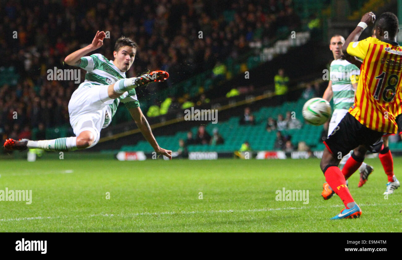Glasgow, Scotland. 29th Oct, 2014. Scottish League Cup. Celtic versus Partick Thistle. Mikael Lustig volleys towards - Stock Image