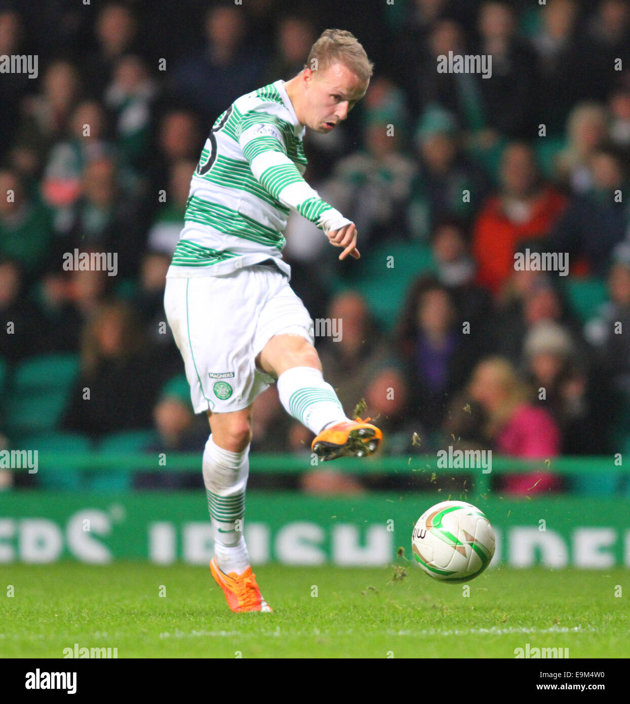 Glasgow, Scotland. 29th Oct, 2014. Scottish League Cup. Celtic versus Partick Thistle. Leigh Griffiths shoots on - Stock Image