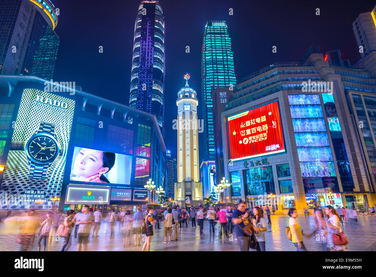 People stroll through the Jiefangbei CBD pedestrian mall of Chongqing, China. - Stock Image