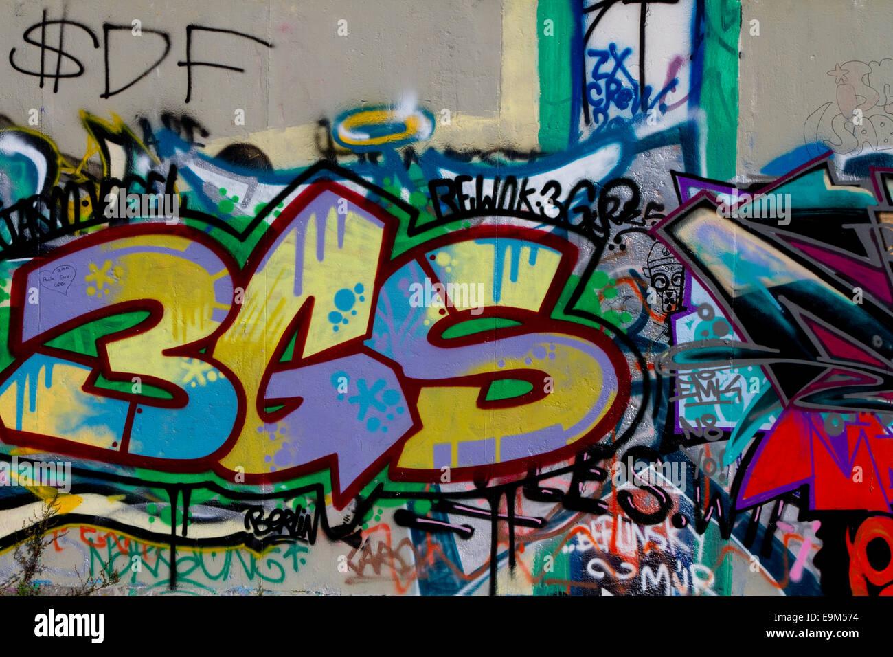 Graffiti street art Berlin Wall tags urban messy Stock Photo ...