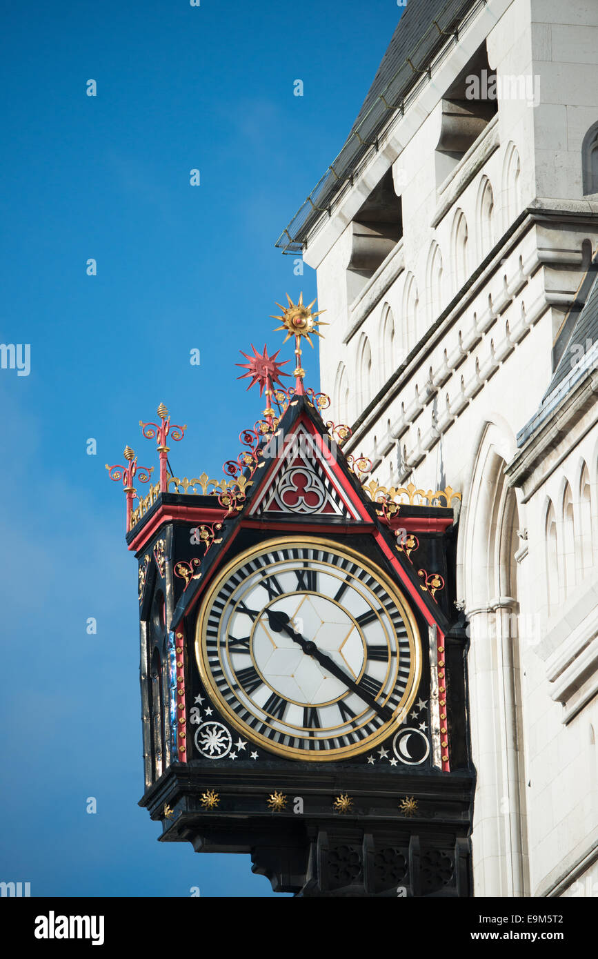 LONDON, UK - An ornate clock on the outside of a building on Fleet Street in central London. - Stock Image