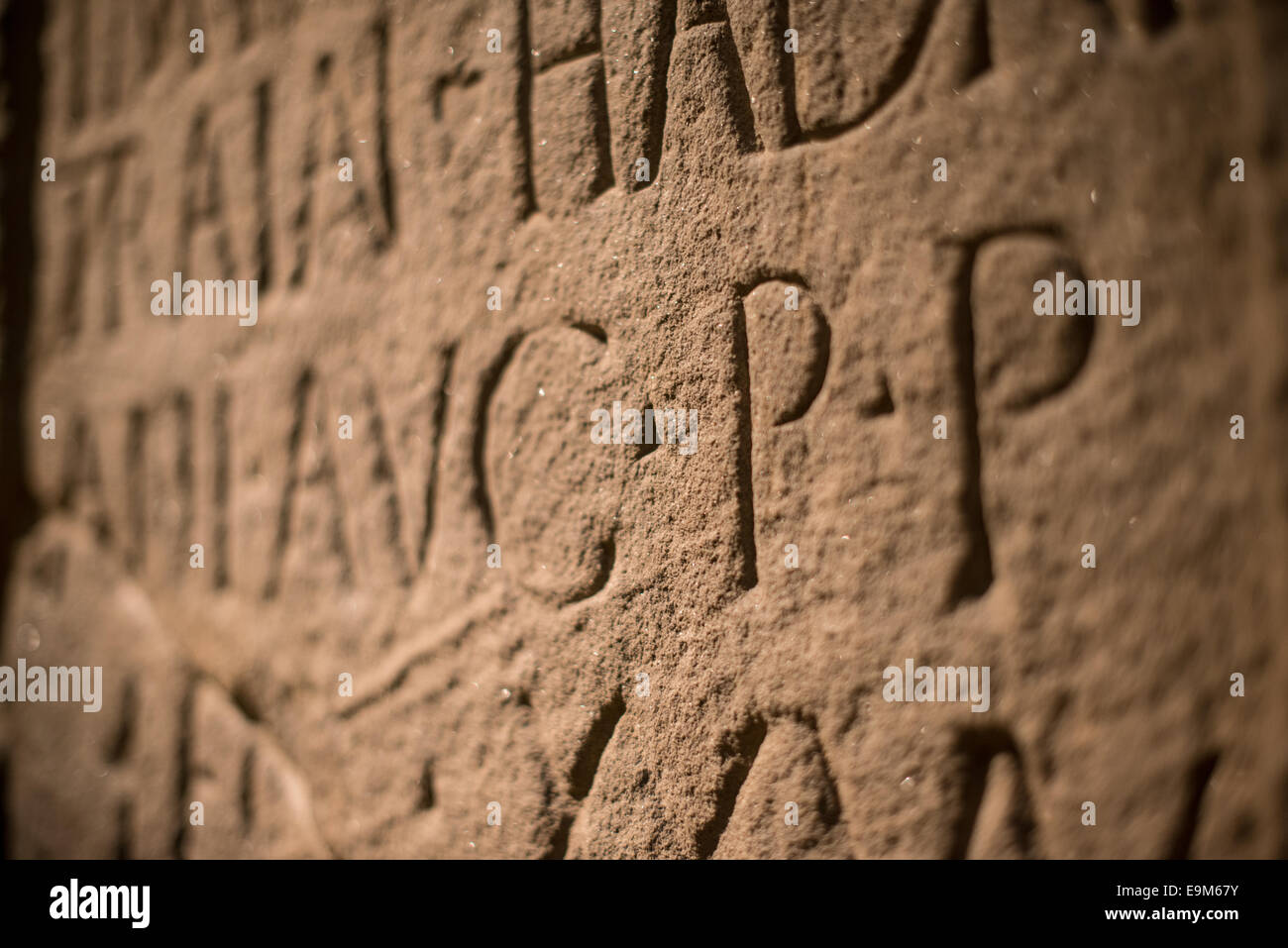 LONDON, UK - A building inscription etched into stone found at the fort of Moresby, Cumbria, on display at the British - Stock Image