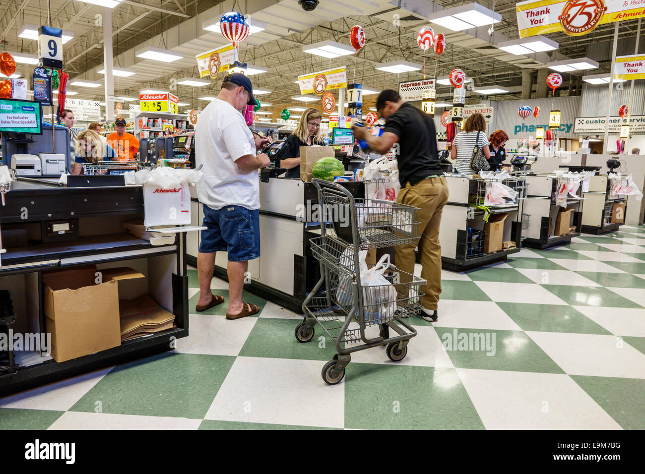 St. Louis Missouri Saint Forest Park Schnucks grocery store supermarket food sale display shopping line queue check - Stock Image