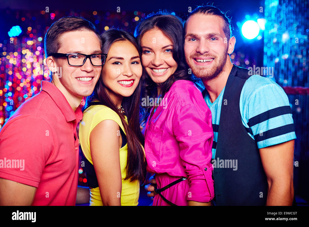 Portrait of two happy couples clubbing together - Stock Image