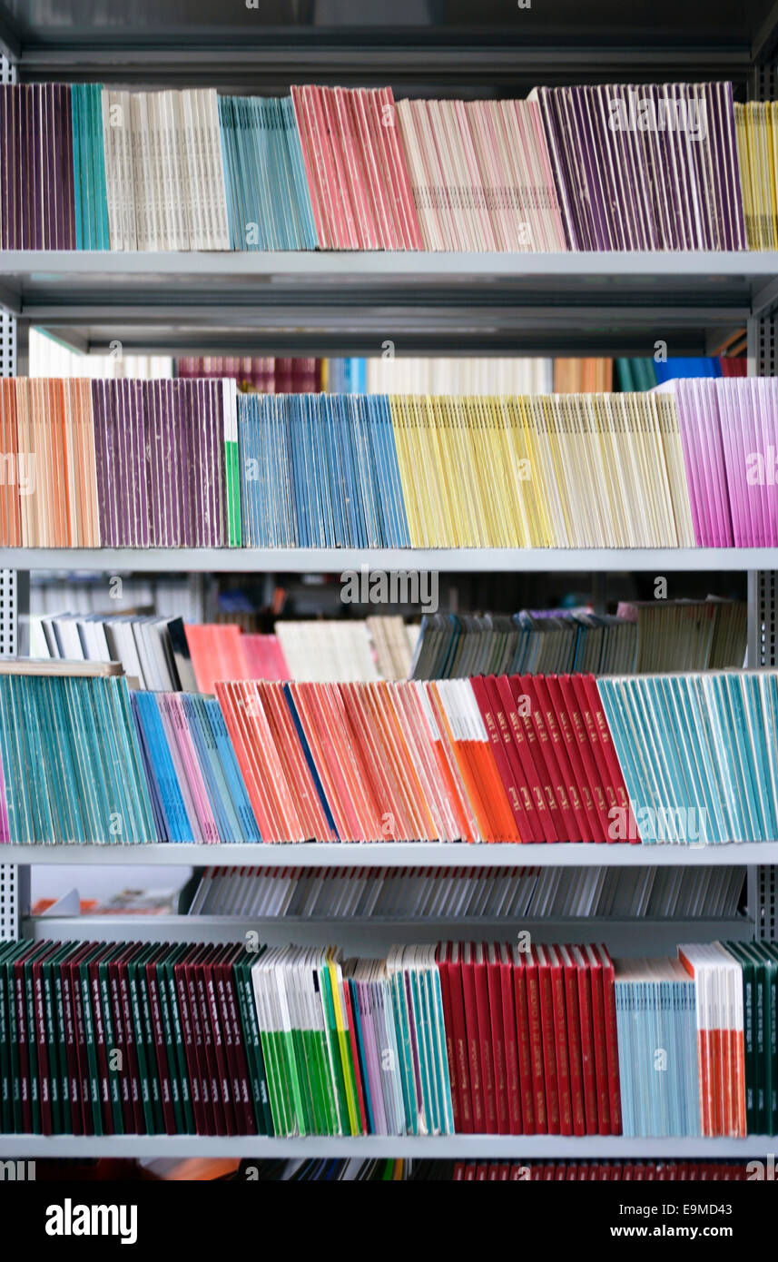 Many colorful books arranged on bookshelves Stock Photo: 74822723 ...