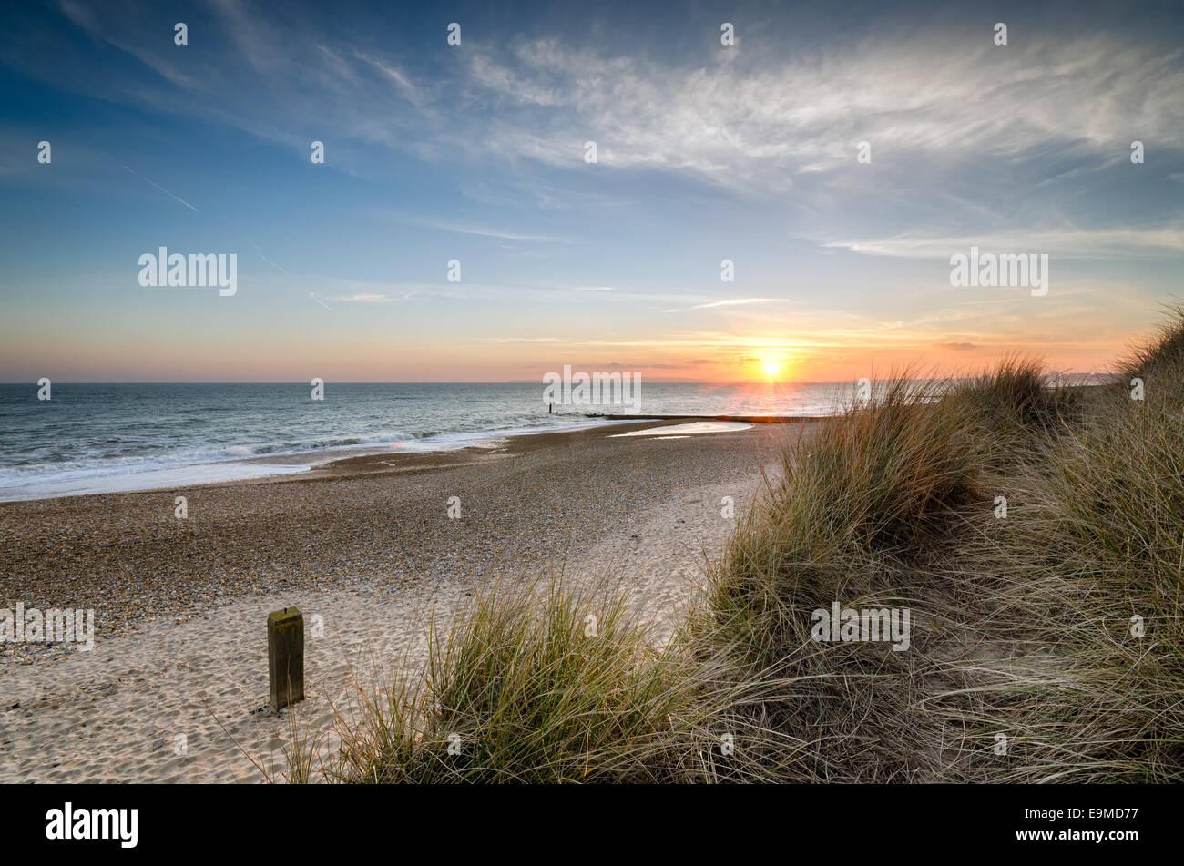 Beautiful sunset at Hengistbury Head beach near Bournemouth in Dorset Stock Photo