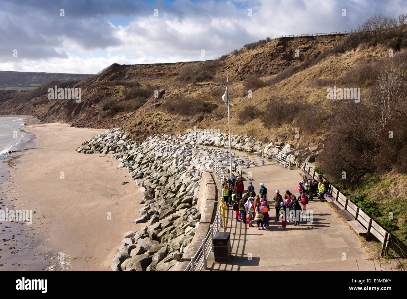 UK, England, Yorkshire, Robin Hood's Bay, group of schoolchildren on the lookout above the beach - Stock Image