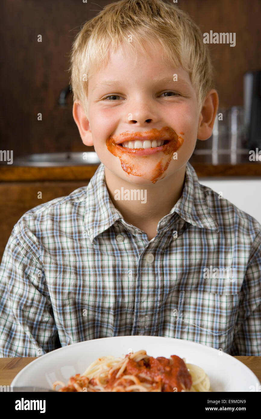 Boy with food around mouth smiling Stock Photo: 74823205 ...