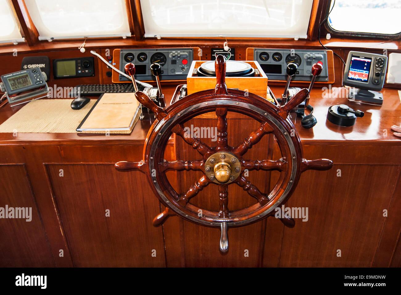 Steering wheel on the bridge of Pelagian liveaboard, Wakatobi Dive Resort, Sulawesi, Indonesia - Stock Image