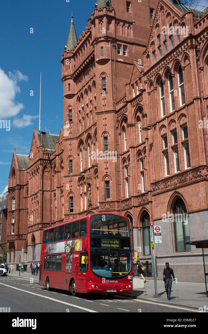 A Volvo B7TL with Wrightbus Gemini Eclipse bodywork operated by Arriva London passes the former Prudential building - Stock Image