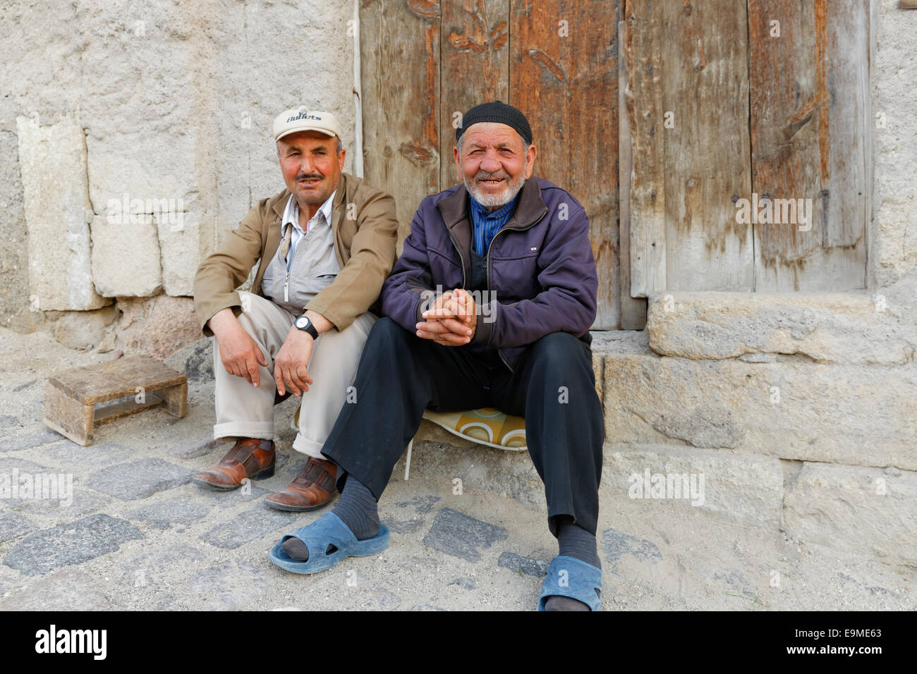 Two sitting men, Ürgüp, Nevsehir Province, Cappadocia, Central Anatolia Region, Anatolia, Turkey - Stock Image