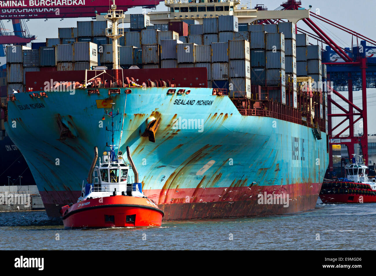 Container Ship Sealand Michiigan being towed by tug boat, Hamburg Harbour, Germany, Europe. - Stock Image