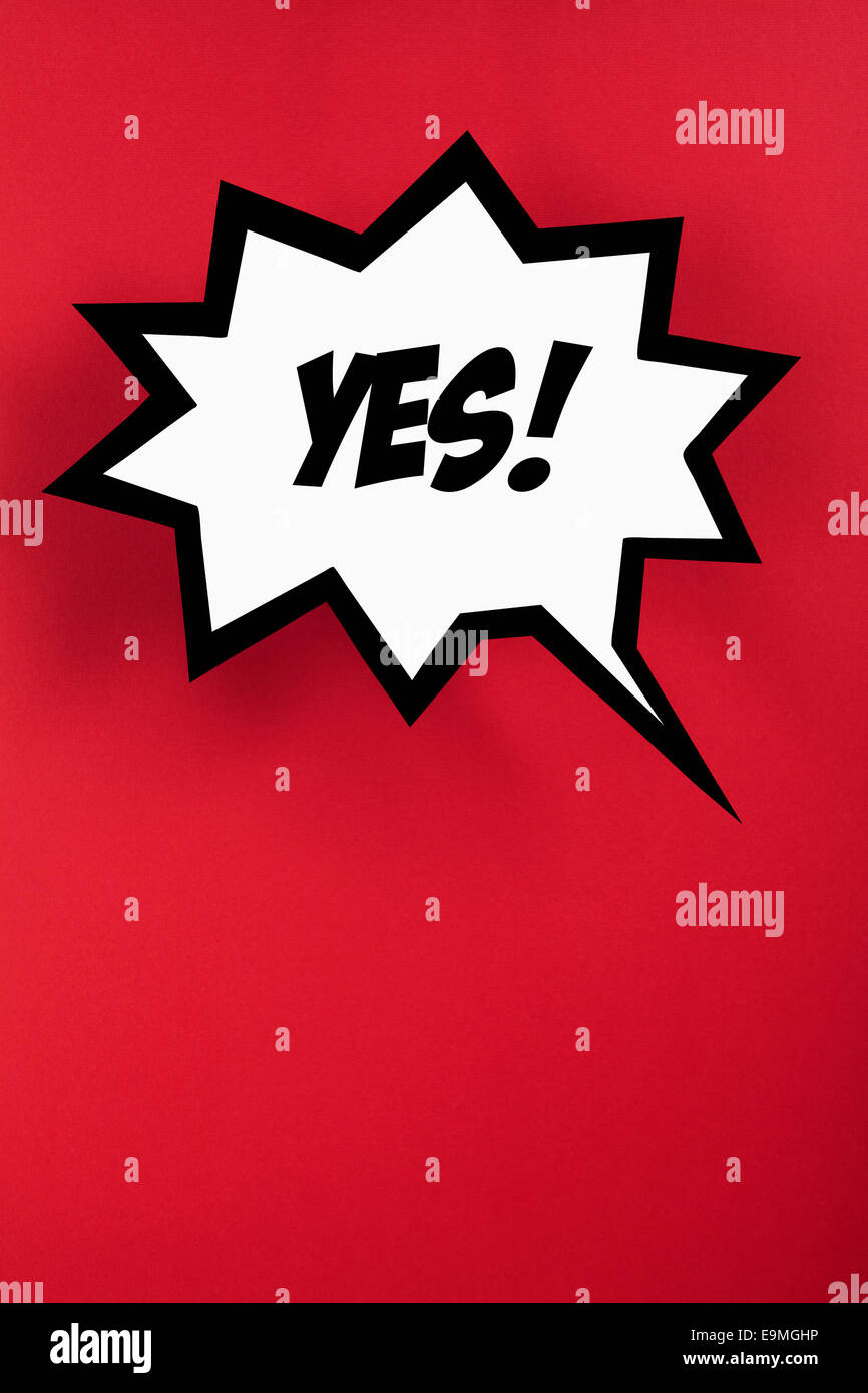 Exploding speech bubble with YES against red background - Stock Image