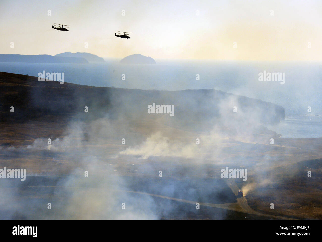 Vladivostok, Russia. 30th October, 2014. Helicopters in flight during a tactical exercise of the Russian Pacific - Stock Image