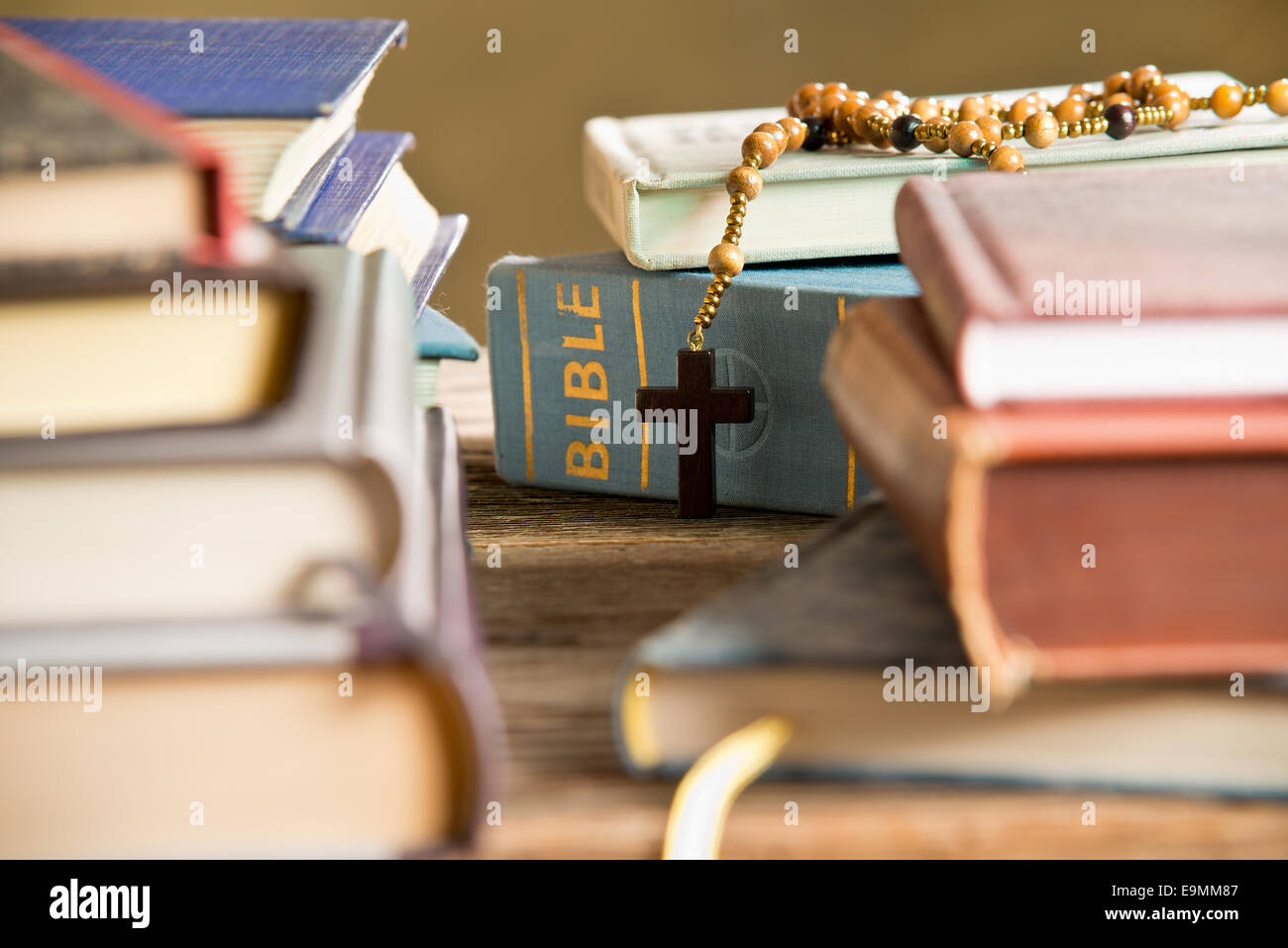 Bible Books And Rosary In The Bookshelf