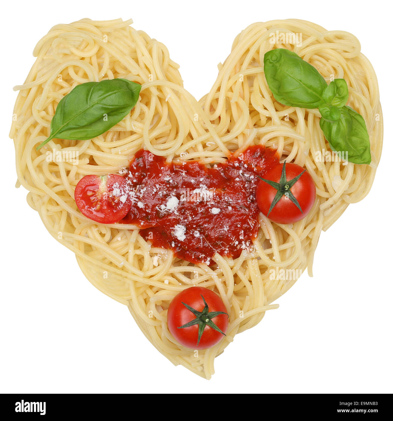 Spaghetti noodles pasta with heart isolated on a white background - Stock Image