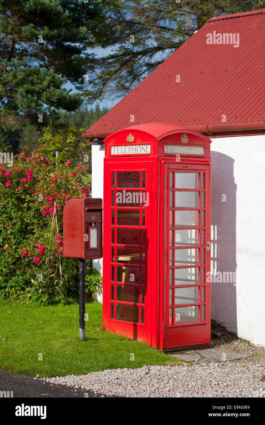 Red Lamp Box post box and telephone kiosk in Scotland - Stock Image