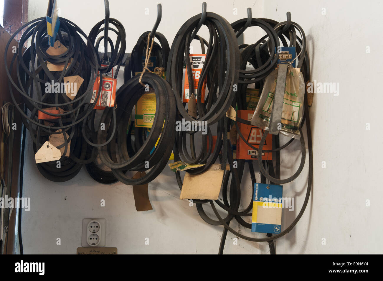 Fan Belts in a Ironware Shop - Stock Image