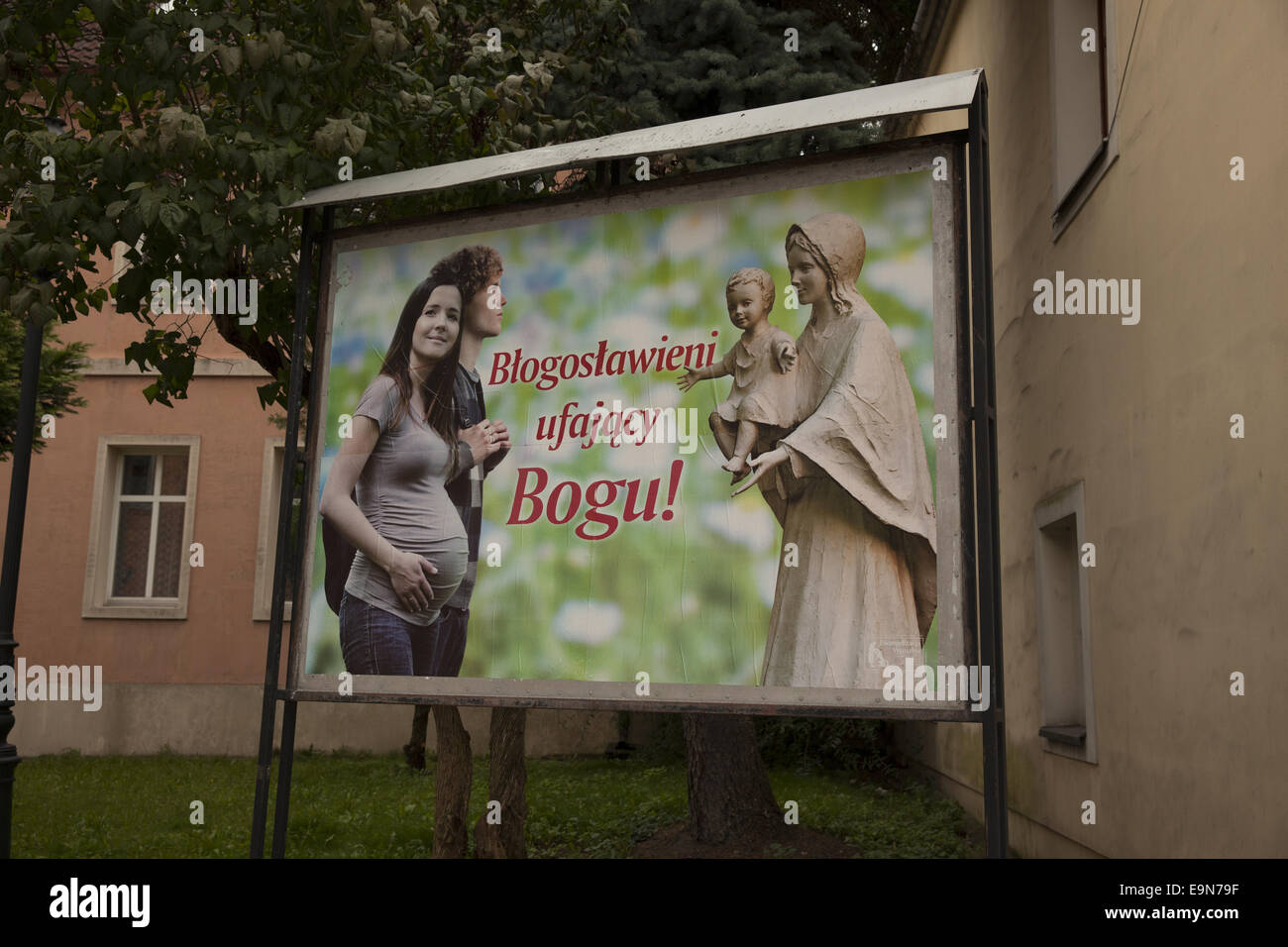 Pro-life billboard near a Catholic Church. 'Blessed are those who gtrust God' Zielona Gora, Poland - Stock Image