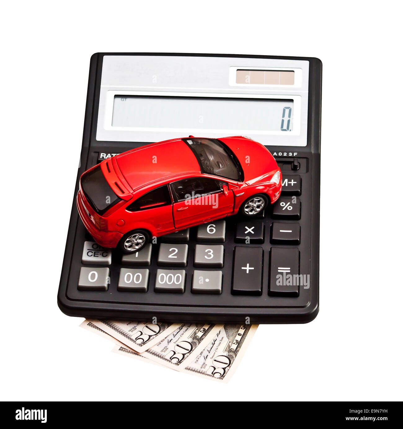 Toy car and calculator over white. Concept for buying, renting, insurance, fuel, service and repair costs - Stock Image