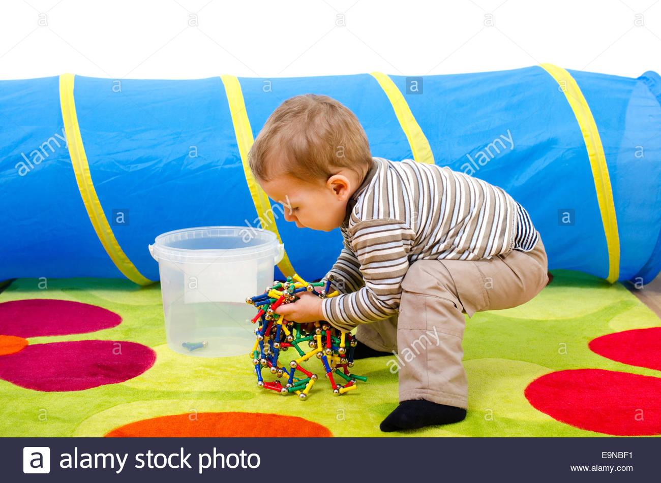 Boy Cleaning Up Toys Stock Photos Boy Cleaning Up Toys Stock