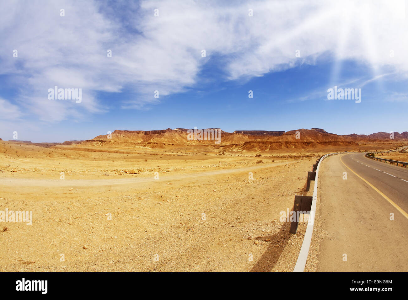 The bright sun shines empty highway - Stock Image
